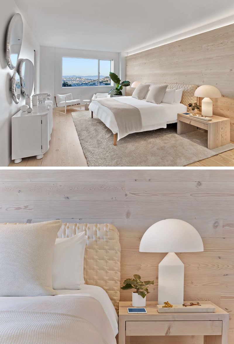 This modern master bedroom features a light wood accent wall that matches the flooring, and a window that perfectly frames the view. #MasterBedroom #ElegantMasterBedroom #LightBedroom #BedroomDesign