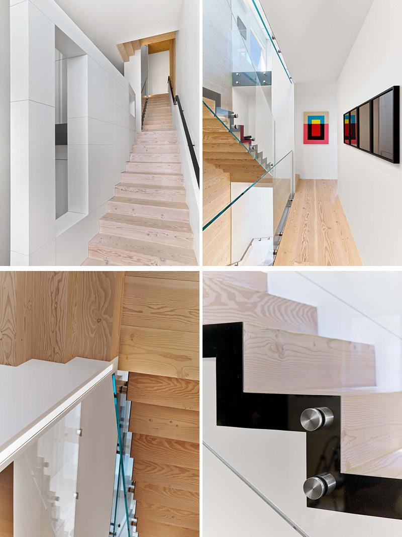Wide-plank reclaimed Douglas Fir floors are featured throughout this modern house, including on the stairs, which combine steel, glass and wood, and connect the multiple levels of the home. #ModernStairs #StairDesign #WoodFlooring