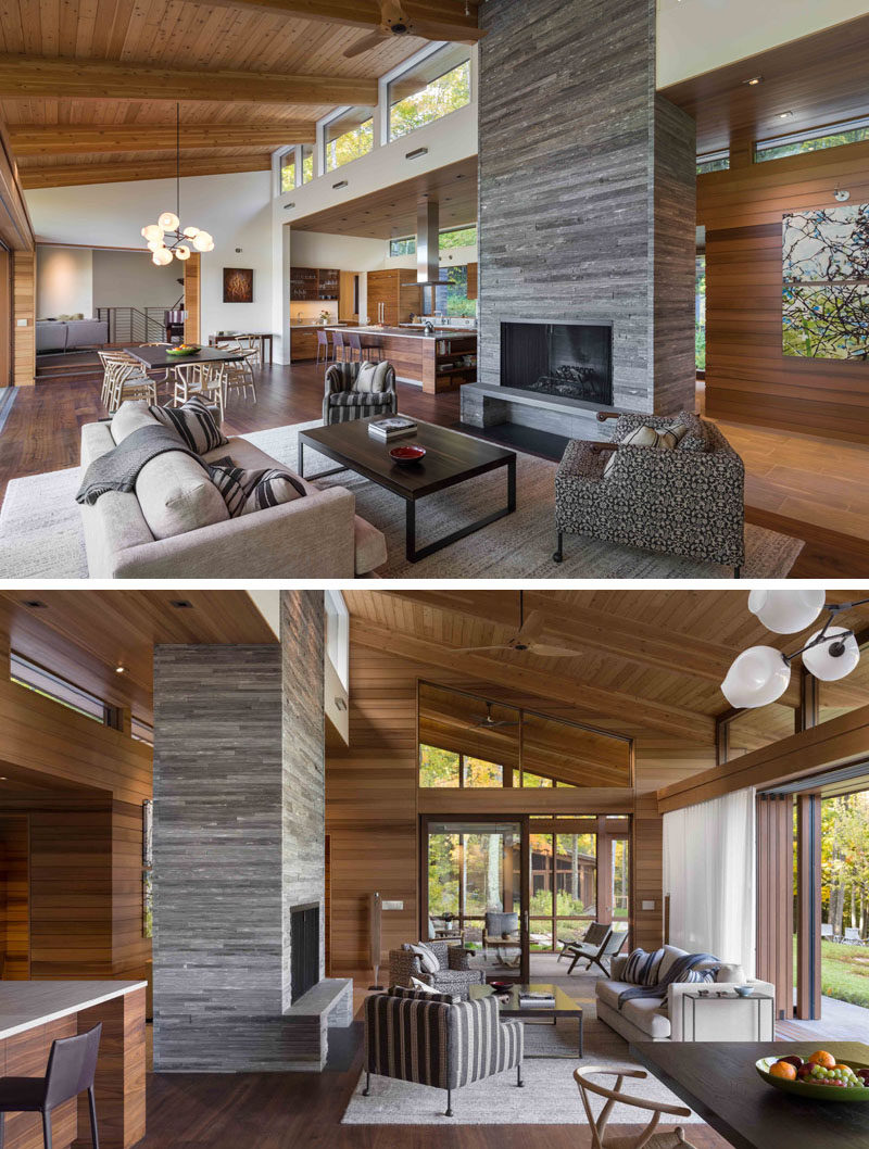 This modern house has an open plan living, dining and kitchen area, with a stacked stone fireplace. #OpenPlanLiving #InteriorDesign #LivingRoom #StackedStone #StoneFireplace