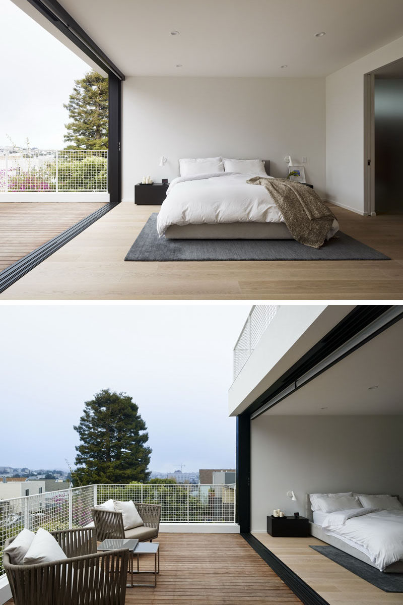 This modern master bedroom opens up to its own private balcony with views of the neighborhood. #MasterBedroom #Balcony #ModernBedroom