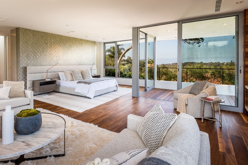 This modern and large master suite is positioned for maximum views and privacy, and it includes a private terrace and a fireplace. #MasterSuite #BedroomDesign #InteriorDesign