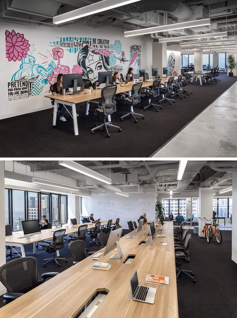 This modern office features custom street art where white walls begged for color brand identity, while long workstations can transform with the company as it grows. #OfficeDesign #Workplace #InteriorDesign