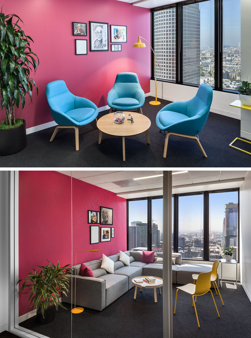 These modern offices have bright pink walls to add a pop of color. #PinkWall #OfficeDesign #MeetingRoom