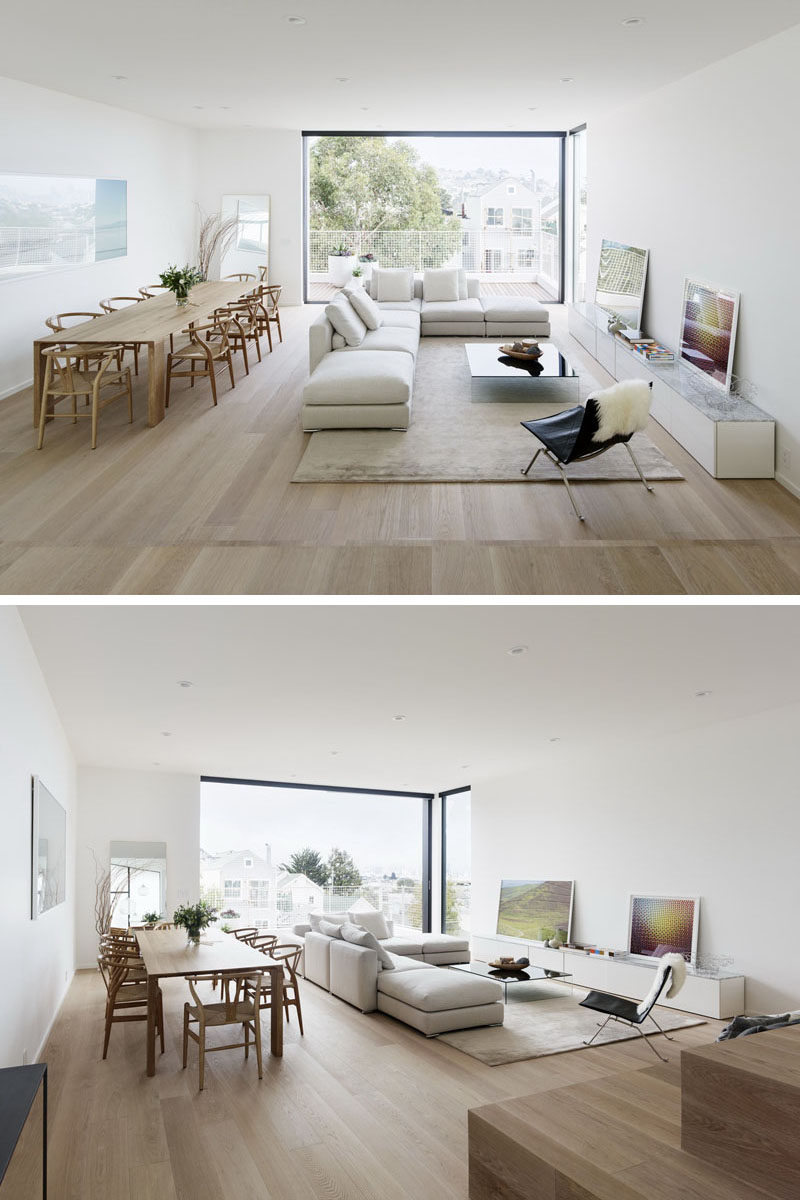 This modern house has an open dining room and living room, and it opens up to a balcony at the rear of the house. #ModernInterior #DiningRoom #InteriorDesign #LivingRoom