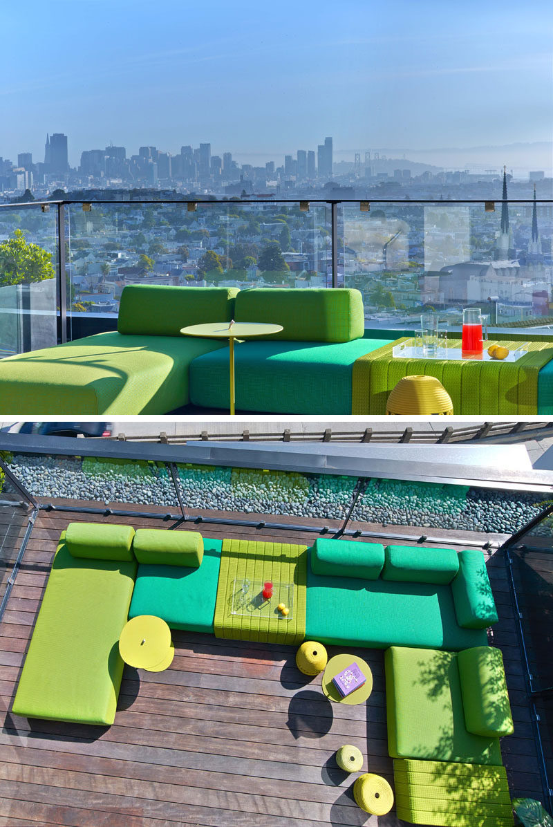 A bright green couch sits on this patio and provides a space for people to relax while taking in the uninterrupted view of the city. #Patio #OutdoorFurniture #OutdoorLounge