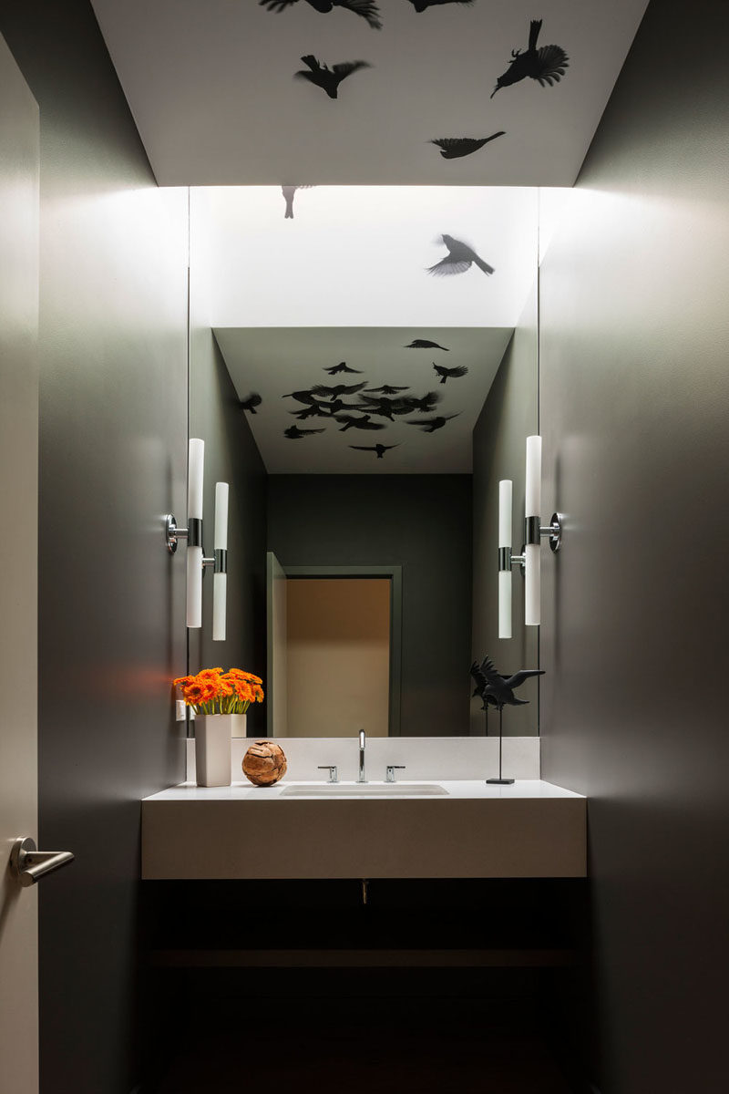 In this modern powder room, a graphic bird wall covering from Trove has been used to create a unique appearance. #Wallpaper #Birds #PowderRoom #Bathroom
