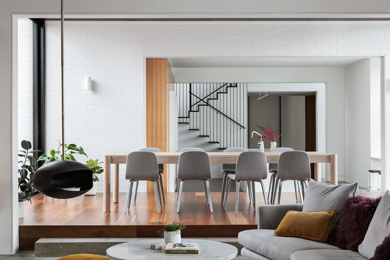 This modern dining room is slightly raised up from the kitchen and living room. #DiningRoom #RaisedDiningArea #ModernDiningRoom