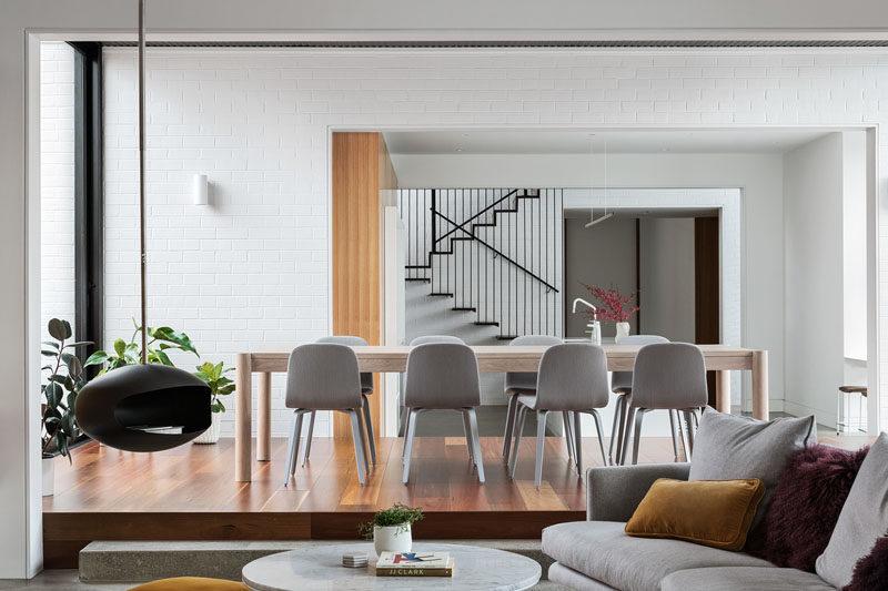 This modern dining room is slightly raised up from the kitchen and living room. #DiningRoom #RaisedDiningArea #ModernDiningRoom