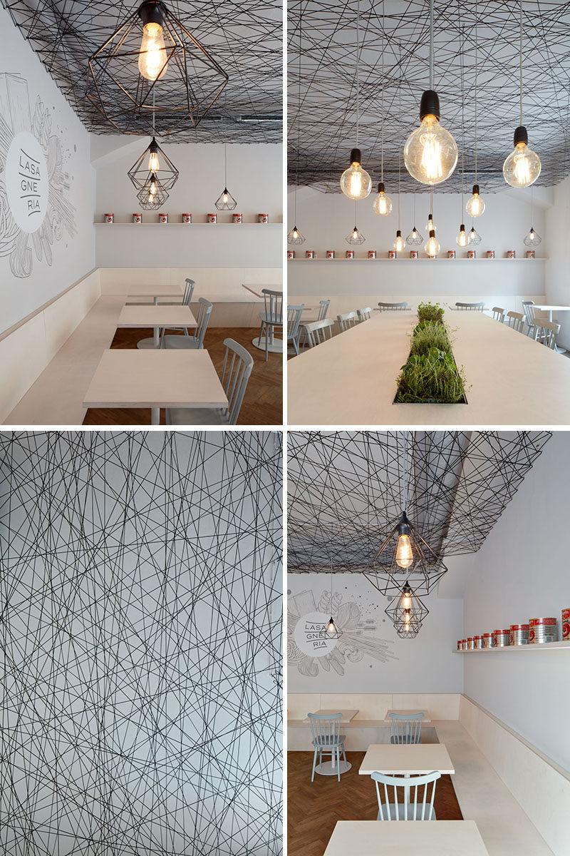 mars.s architects have designed a modern bistro with an irregular web semi-transparent suspended ceiling made from black string. #ModernBistro #ModernInterior #ModernRestaurant #InteriorDesign #Ceiling
