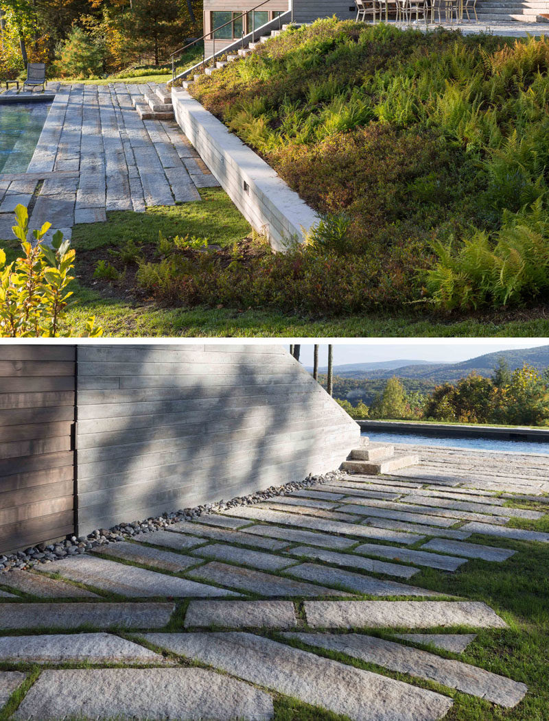 A series of board-formed concrete retaining walls and planted slopes negotiate the outdoor spaces of this modern house, which are overlaid with paths and seating areas using reclaimed granite curbs from Massachusetts and New Hampshire. #Landscaping #Stone #Paths #Garden #RetainingWalls