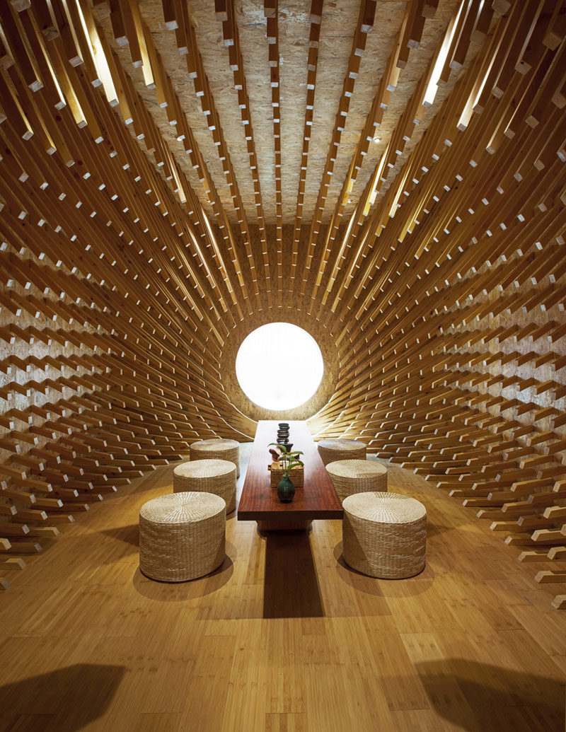 MINAX Architects have designed ONE Teahouse, a modern tea room that has 999 wooden sticks that surround the room, creating a sculptural design. #Teahouse #TeaRoom #InteriorDesign #Interiors #Wood #Sculpture