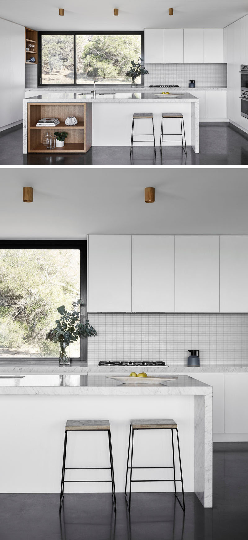 In this kitchen, minimalist white cabinets have been combined with touches of exposed wood shelving, which are both a strong contrast to the dark flooring and window frame. #ModernKitchen #MinimalistKitchen #KitchenDesign #WhiteKitchen