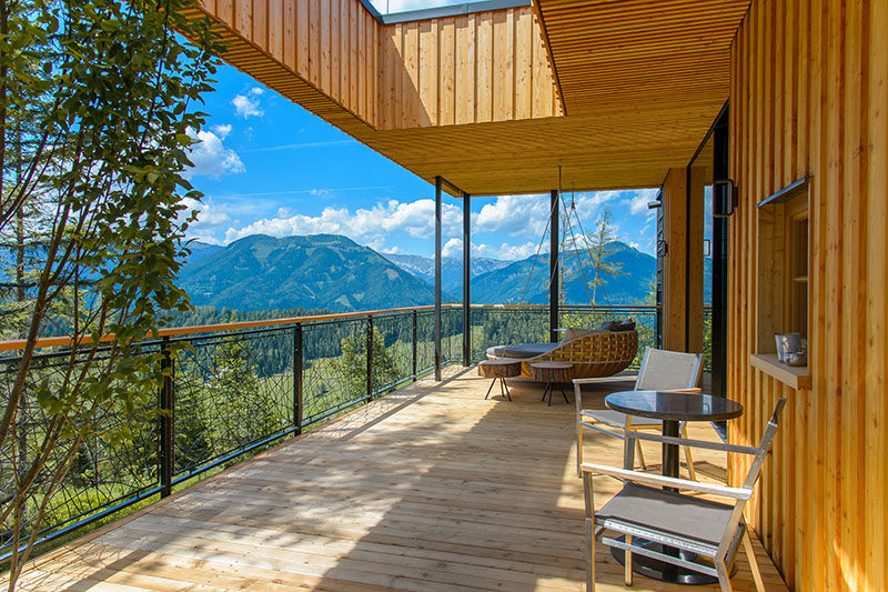 This modern chalet in Austria features a large balcony that looks out towards the mountains. #Balcony #Chalet