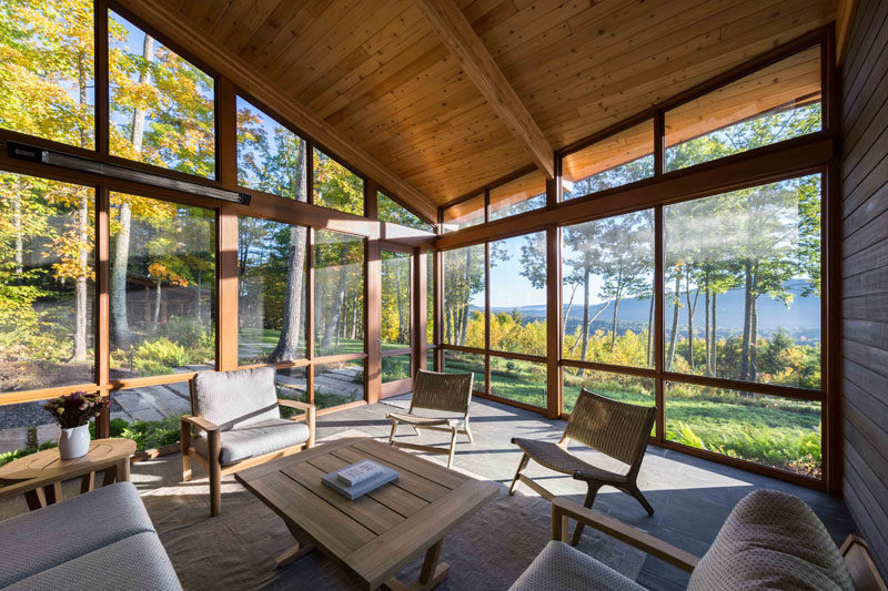 This modern house has a large screened in porch with views of the trees. #Porch #EnclosedPorch #Sunroom