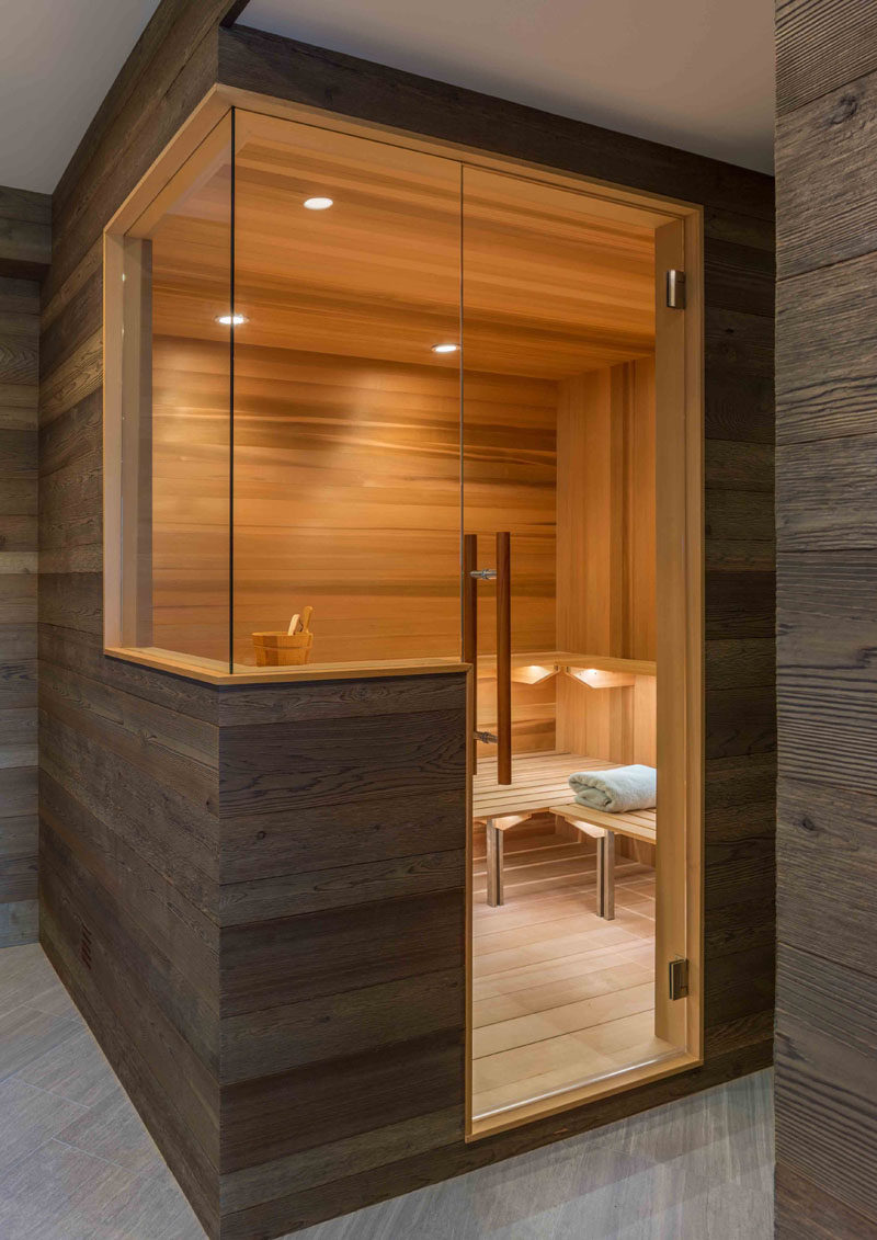 This modern sauna has been specially designed to include glass panels that provide continuous views. #Sauna #ModernSauna