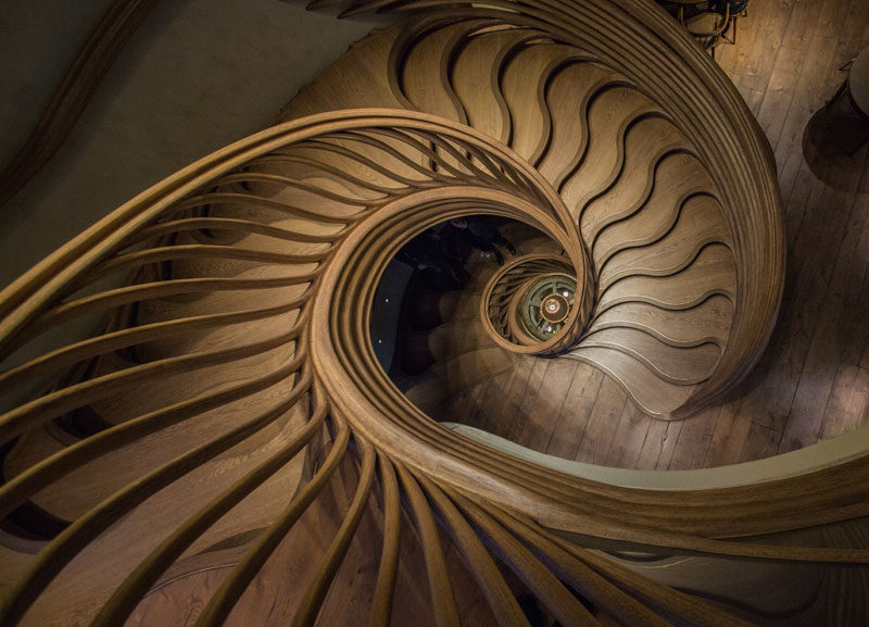 Atmos Studio have designed a sculptural wood spiral staircase that's the centerpiece for the 3-storey HIDE restaurant in London. Click through to see more photos of the staircase. #SpiralStairs #SculpturalStairs #Architecture #Design #WoodStairs