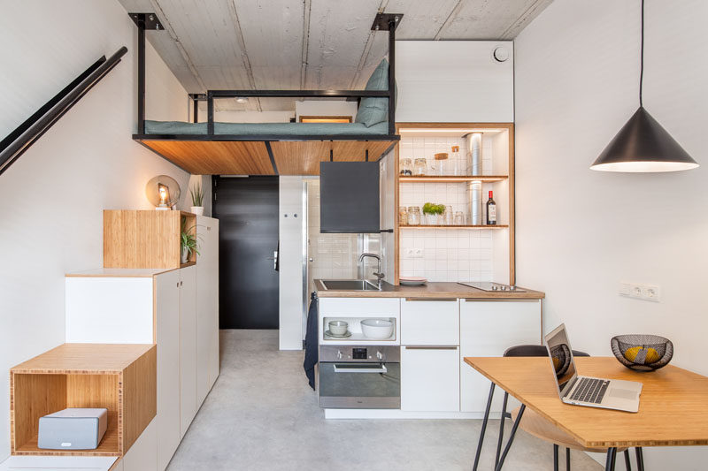 This Small Apartment Has A Loft Bed Suspended From The Ceiling