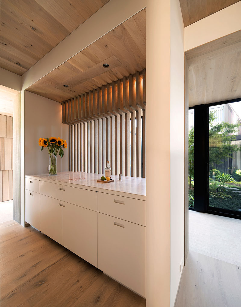 This house features cabinetry with built-in drawer pulls and a light countertop. #Cabinets #WhiteCabinetry