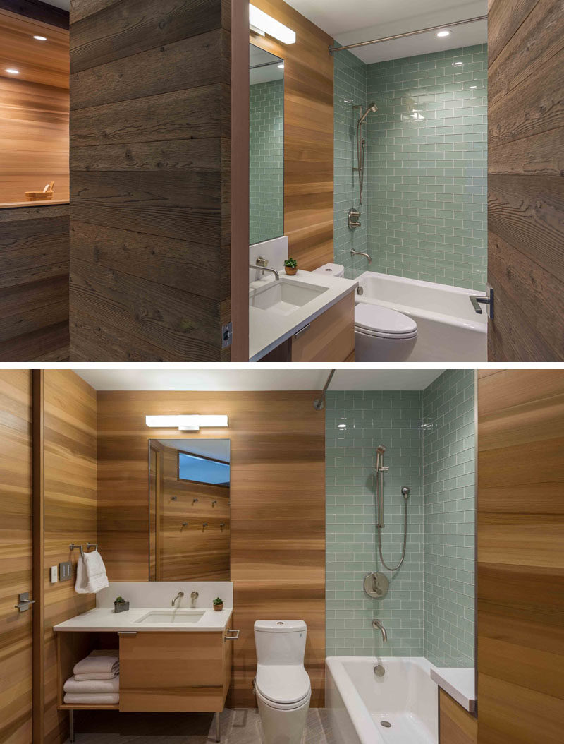 This modern bathroom has cedar clad walls and light green tiles. #ModernBathroom #CedarWalls #CedarBathroom #BlueTiles