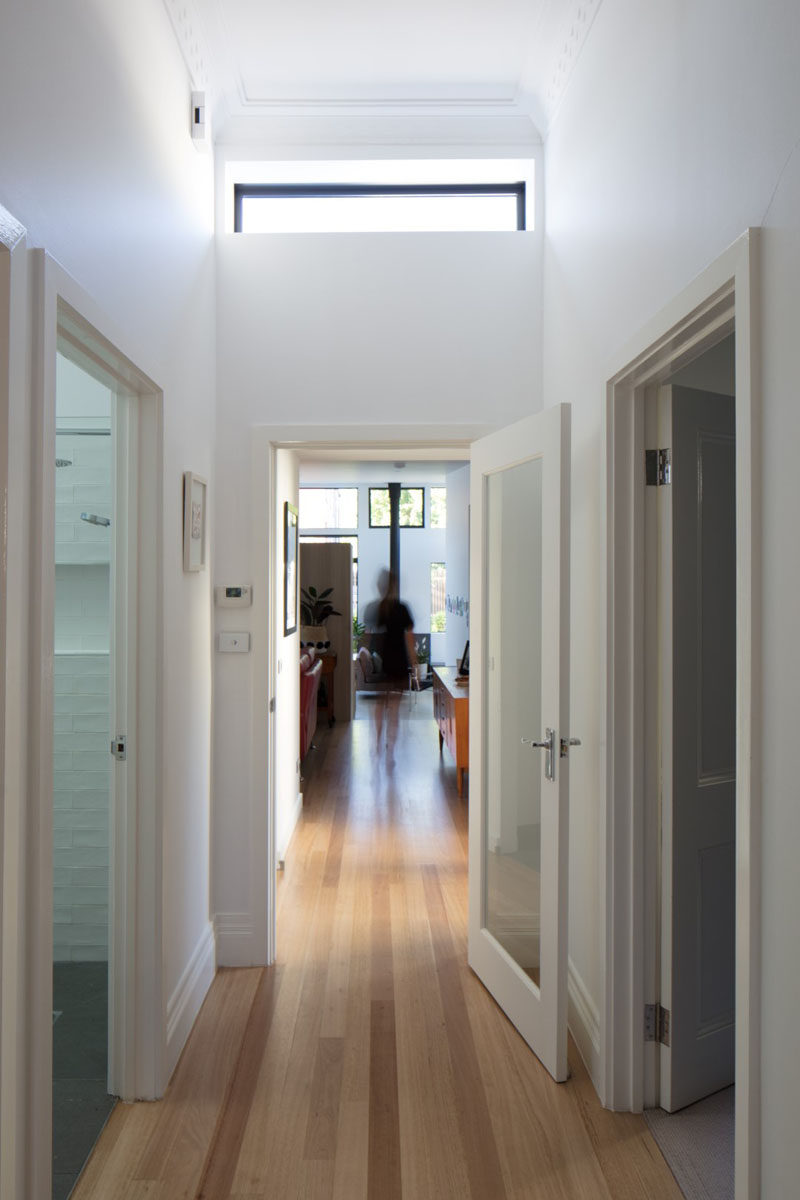 This renovated Australian cottage has light wood floors and a hallway that leads to a new extension. #Hallway #LightWoodFloors