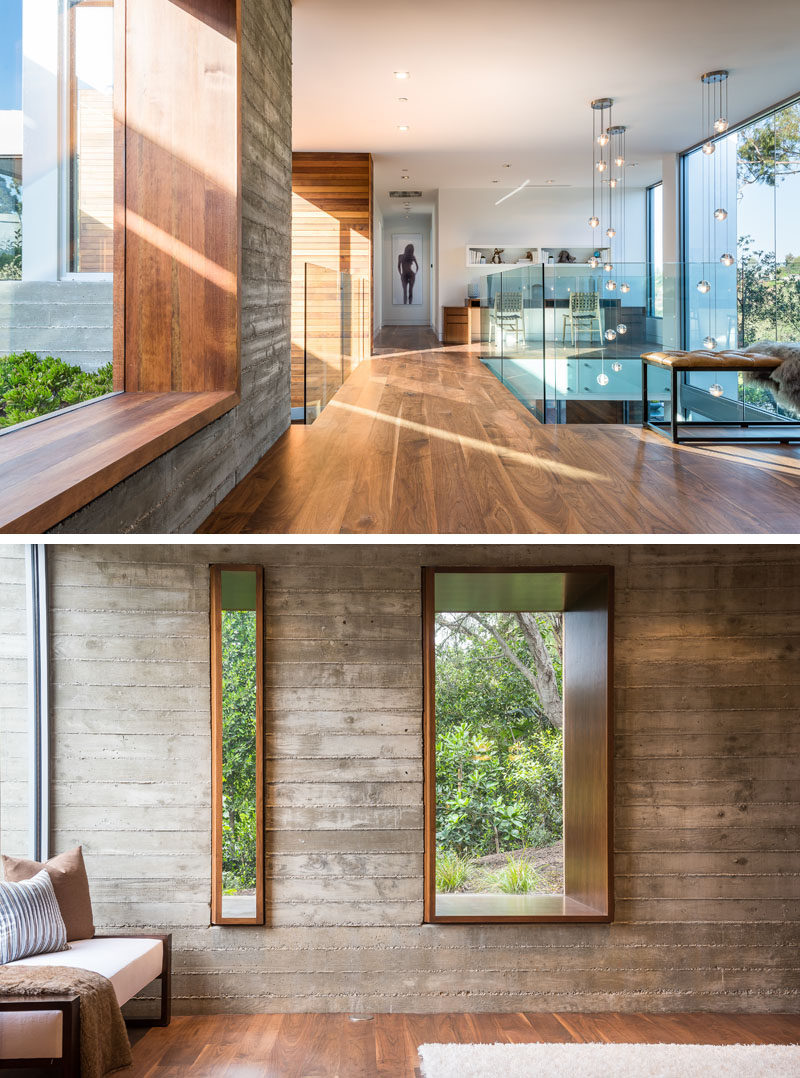 This modern house has a small bridge with glass guardrails that leads to the bedrooms. The window next to the bridge features a deep wood frame that's wide enough to sit on. #Windows #InteriorBridge #InteriorDesign