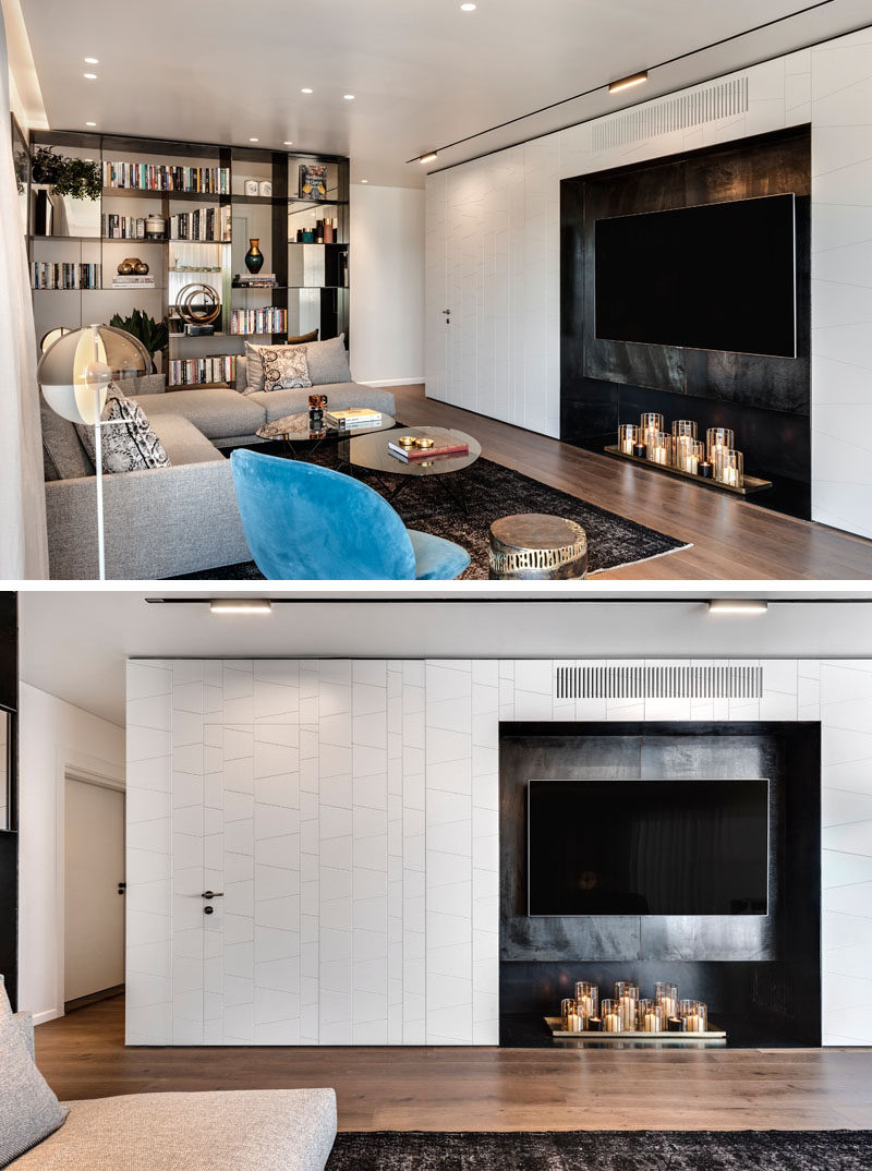 This modern living room has a white wall with a shallow alcove that houses the television. #Television #LivingRoom #InteriorDesign