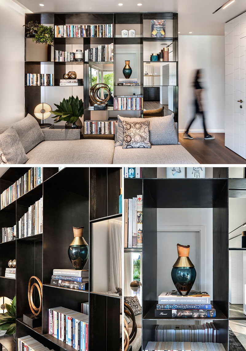 This modern black metal open shelving unit allows light to travel through to the hallway, and at the same time provides a place to display personal items. #RoomDivider #ShelvingUnit
