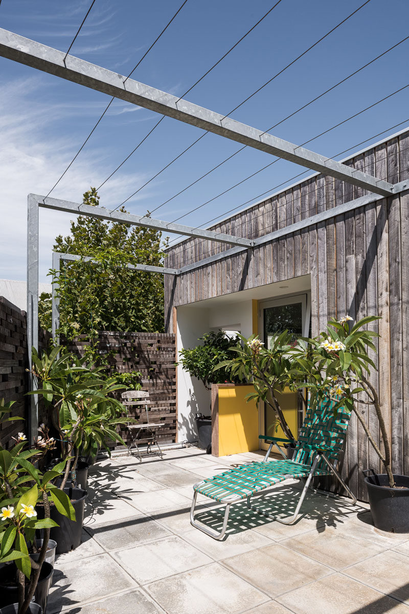 This private patio is surrounded by wood, and an overhead trellis will allow plants to create a shade cover over the outdoor space over time. #Patio #OutdoorSpace