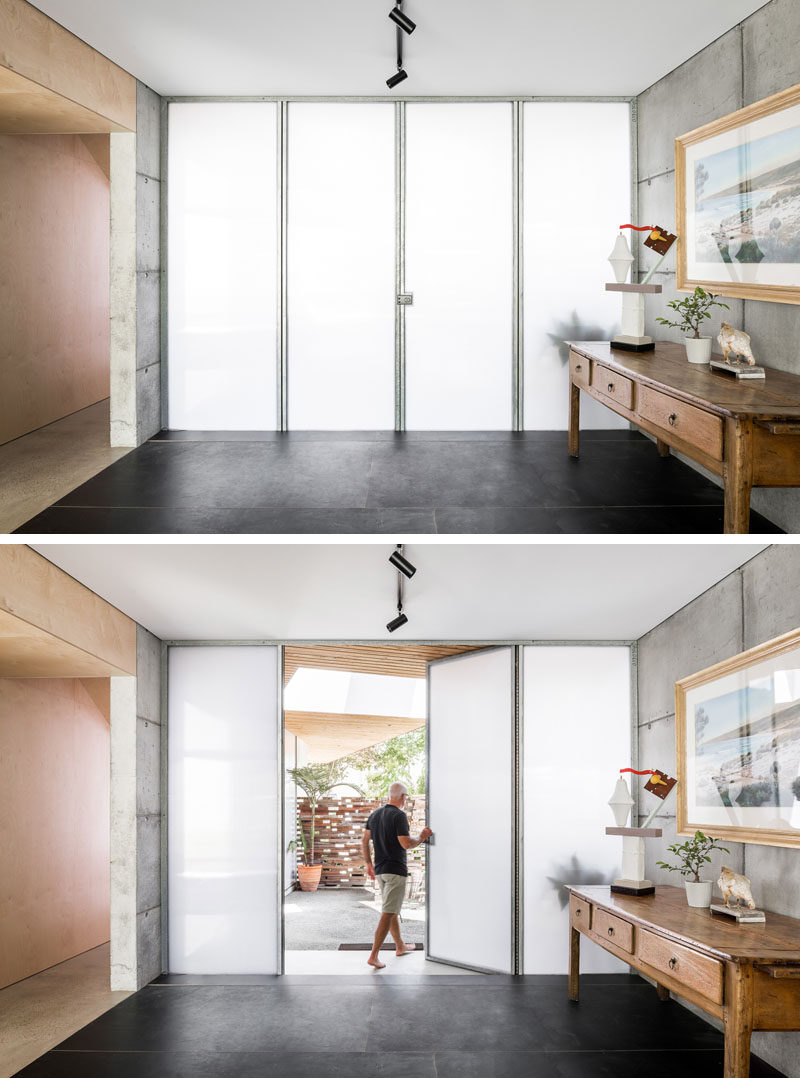 Materials such as wood, concrete, and opaque walls and doors, have been used throughout the interior of this modern house. #OpaqueWall #Concrete #Wood