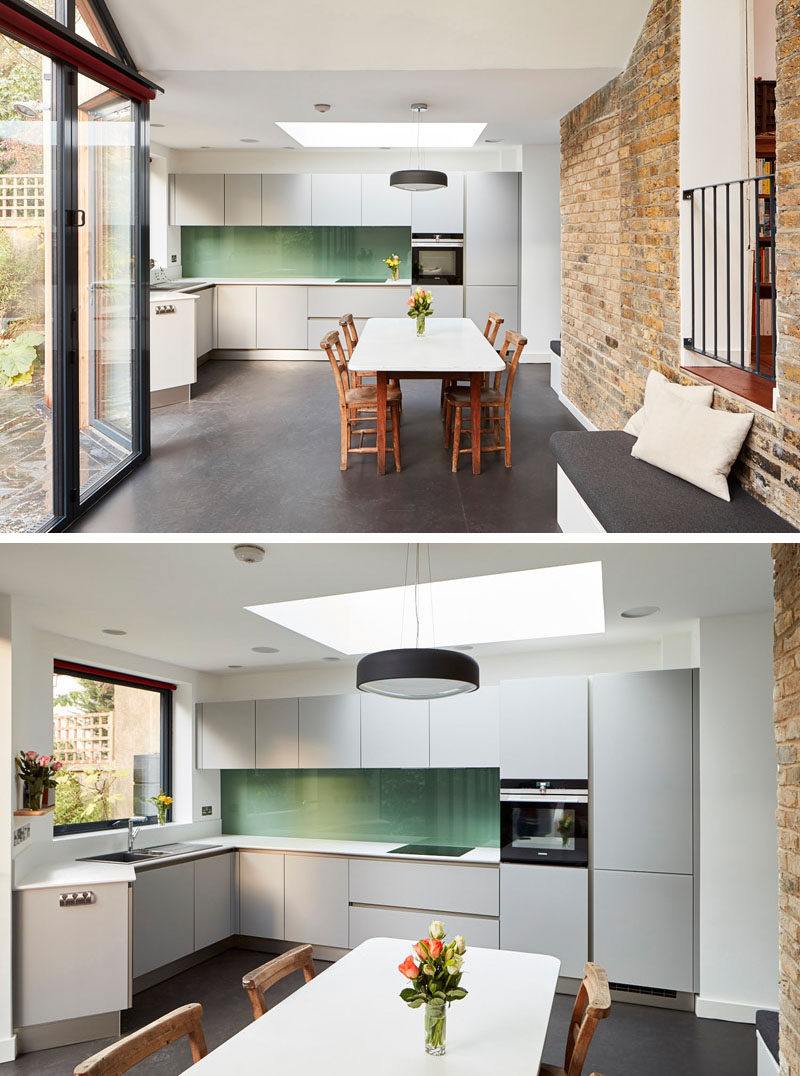 This old house has a new extension with a kitchen that features light grey cabinets, white countertops and a green backsplash. #KitchenDesign #SimpleKitchen #GreyCabinets