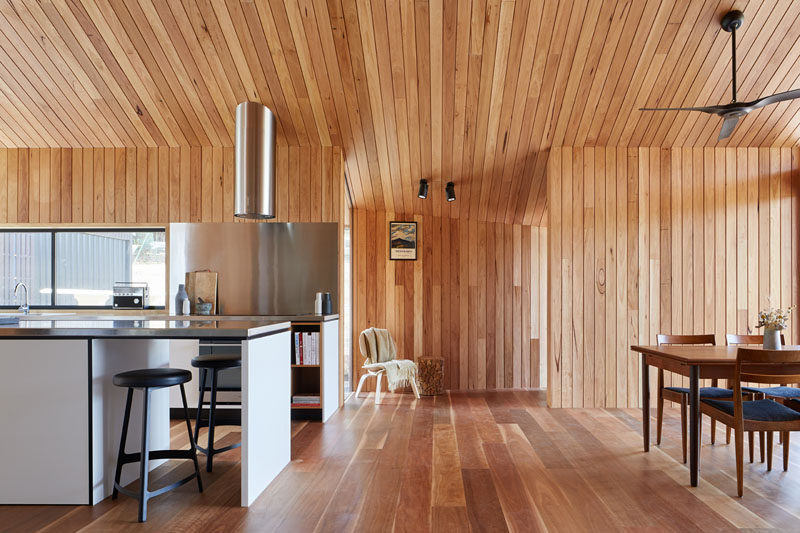 This modern wood-lined house extension is a large open room that houses the kitchen and a dining area.  #WoodInterior #ModernWoodInterior #InteriorDesign