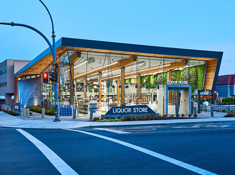 GBL Architects have recently completed theTudor House Liquor Store in Victoria, Canada, that has a striking glass facade. #ModernRetailStore #ModernArchitecture #RetailDesign