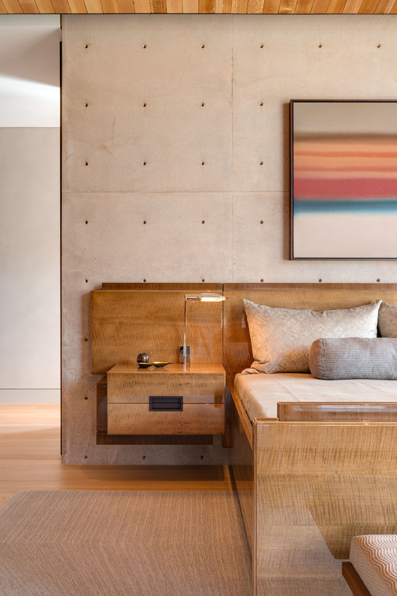 Cast in place concrete walls have been used as a design element in this modern bedroom. #ConcreteWalls #BedroomDesign