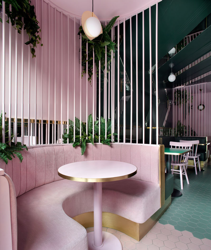 This modern cafe has open velvet caged booths that creating a separation between the different seating areas. #ModernCafe #CafeDesign #InteriorDesign