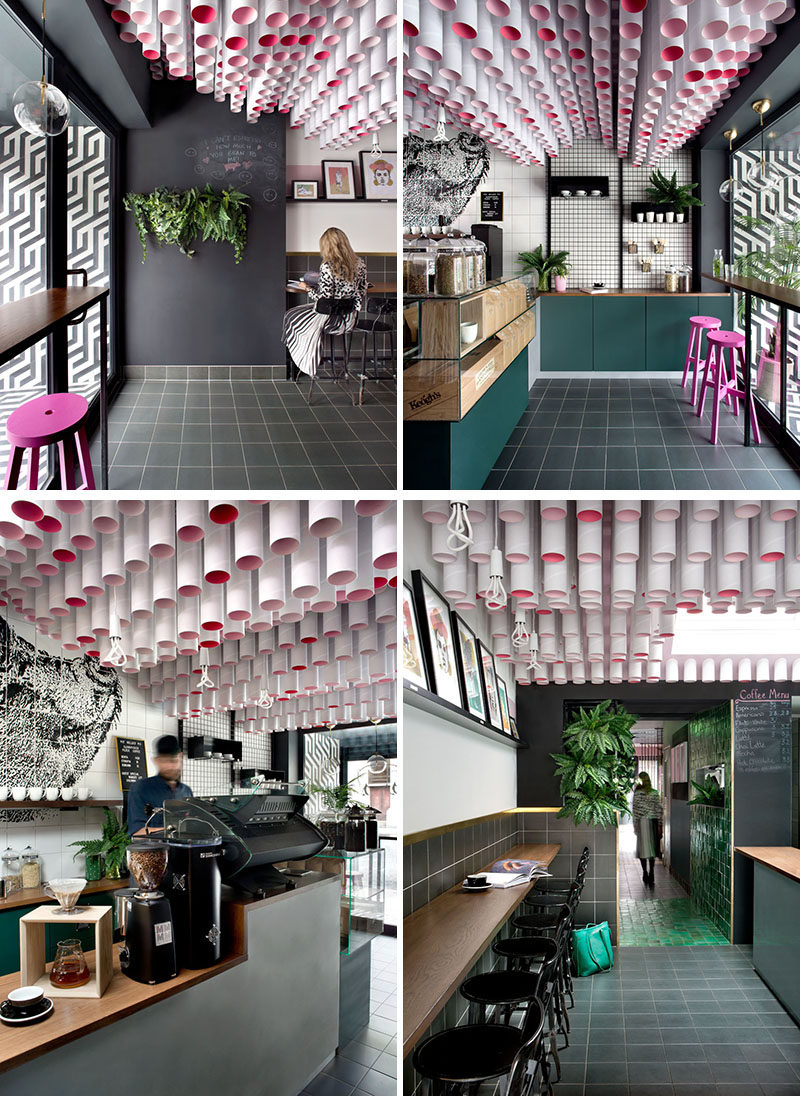 The front section of this modern cafe features an installation of tubed lighting that drew inspiration from a pig's snout.#CafeDesign #CeilingInstallation #InteriorDesign