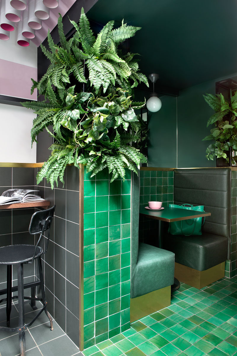This modern cafe uses a variety of materials in pink, green and grey, to create a unique experience. #CafeInterior #CafeDesgin #GreenTile