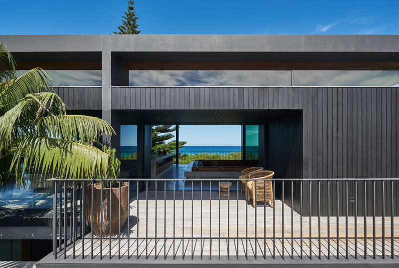 Large sliding glass doors that help to create air flow within this modern beachfront house. #ModernHouse #Architecture