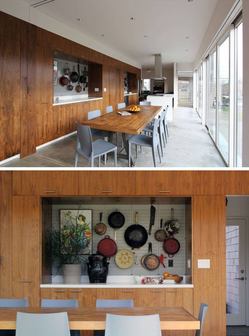 This modern great room consists of anopen plan kitchen / dining/ living area, as the home owners love to entertain guests. #OpenPlan #InteriorDesign #DiningRoom #WallDisplay