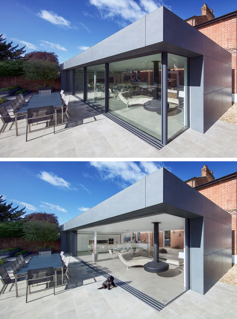 This modern extension has large double-glazed sliding doors that effortlessly open up to blur the distinction between inside and outside living areas. #Extension #SlidingGlassWalls #ModernAddition #Architecture