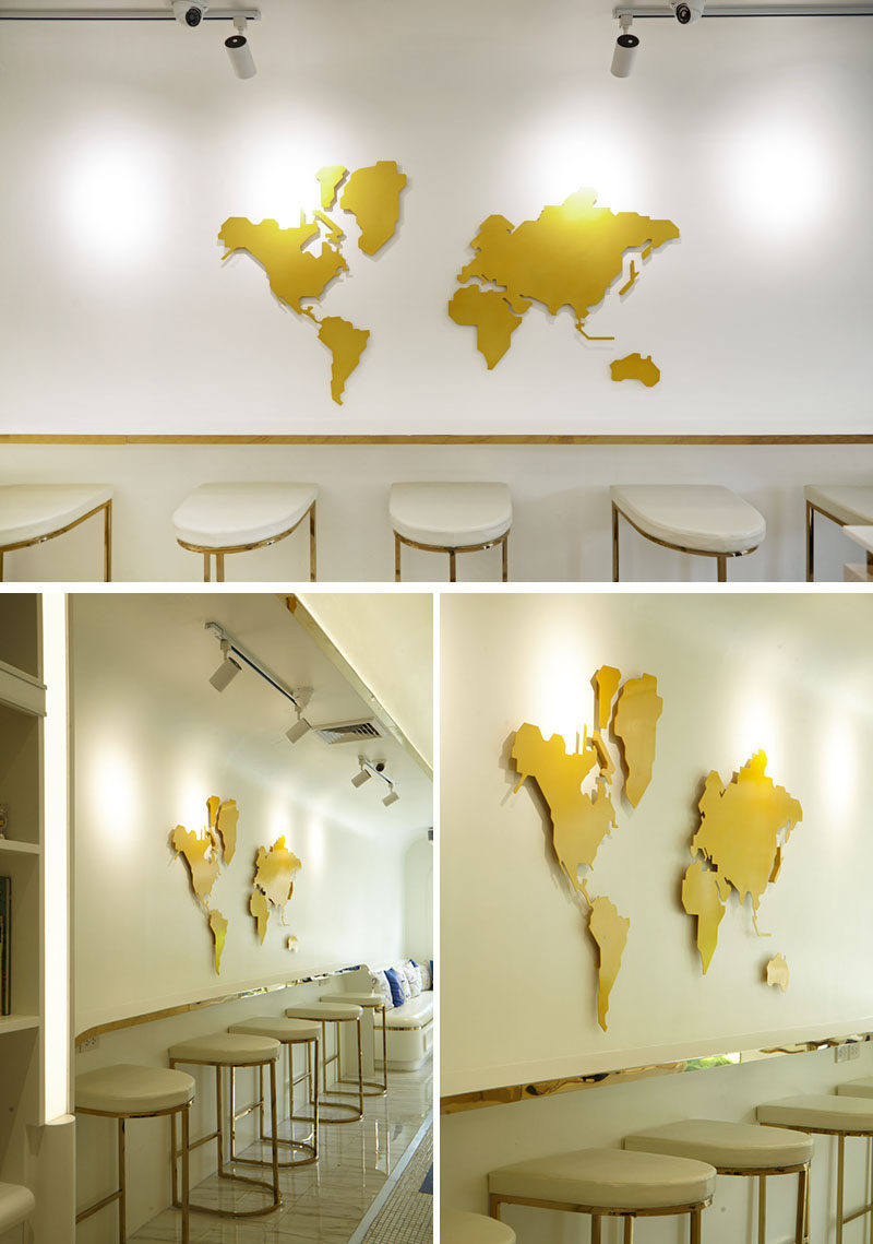 This modern gelato boutique features a world map on the wall above a row of bar seats. #WorldMap #RetailDesign #Cafe