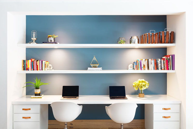 This modern homework station (or home office) has a blue wall that helps to make the white shelving stand out. #HomeworkStation #HomeOffice #BuiltInDesk