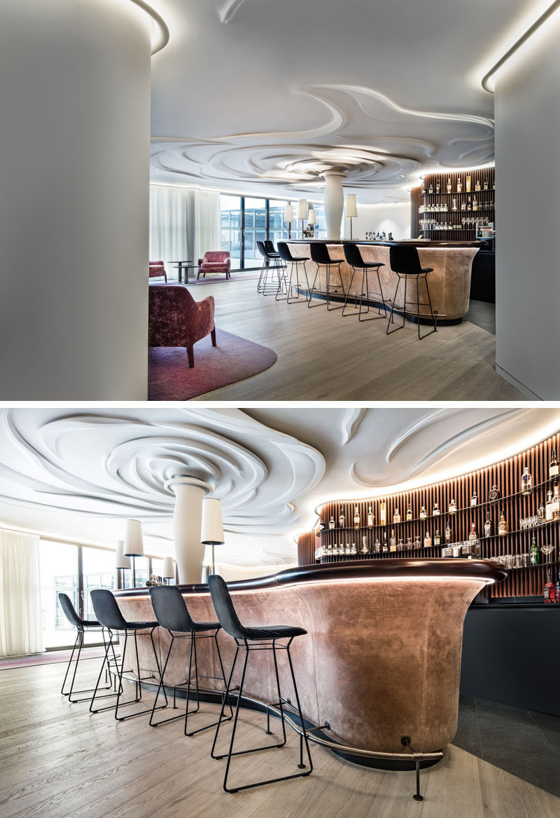 Nature was the inspiration in this modern bar and lounge area, and it has been represented through a 100-sq-m sculpted rose on the ceiling. #Ceiling #Sculpture #Bar
