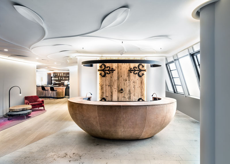 The lobby of this modern hotel draws inspiration from the historic town, with wood and black metal accents. #Lobby #HotelLobby #InteriorDesign