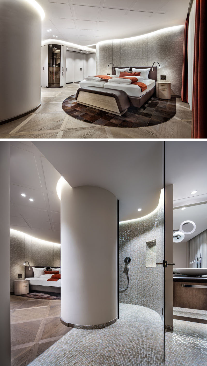 In this hotel room, the ceiling has a delicate square pattern, while the bathroom is tucked away behind a curved column. #HotelRoom #HotelDesign #HotelInterior