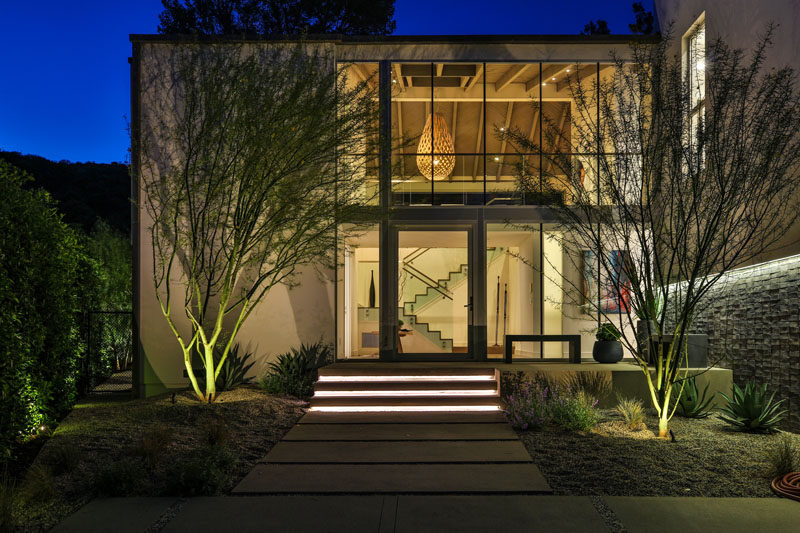 Assembledge+ have designed the modern renovation of a 1970s home in Los Angeles, and turned it into a two-storey house that features the main living areas on the second floor. #Architecture #Windows #ModernHouse