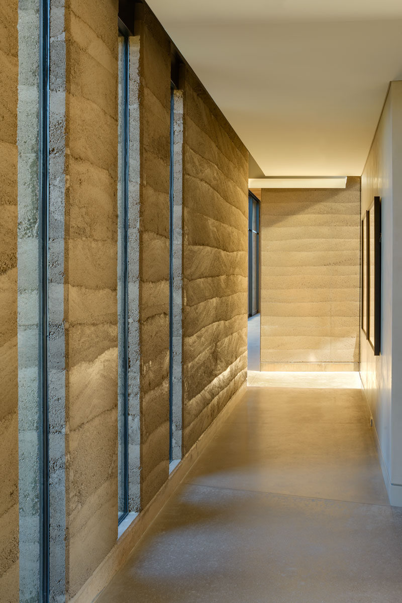 The rammed earth walls add a natural element to his modern home, with the clearly defined layers creating a subtle artistic quality. #RammedEarthWalls #RammedEarth #Architecture