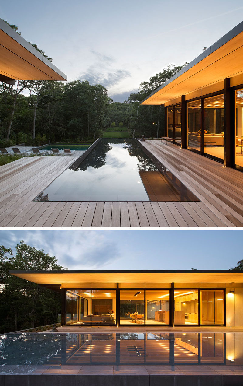 This modern house has a reflecting pool that sits between the two wings of the home. #ReflectingPool #WaterFeature