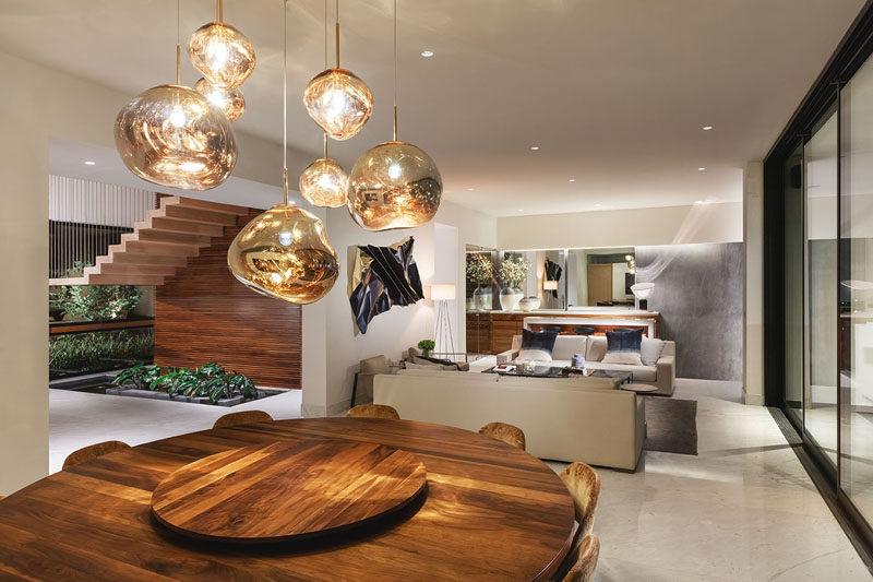 This modern interior features wood elements throughout its design. #ModernInterior #ModernHouseInterior