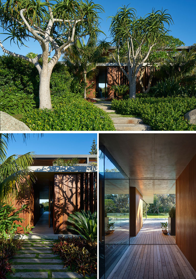 This modern house has lush landscaping with a path that leads to the front door and adds to the overall curb appeal of the home. #Landscaping #Garden #CurbAppeal