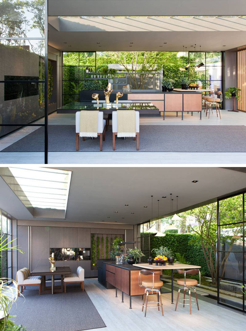 This modern garden pavilion with glass walls features a dining area and kitchen with a living wall. #GardenPavilion #InteriorDesign #LandscapeDesign